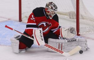Cory Schneider deflecting a shot