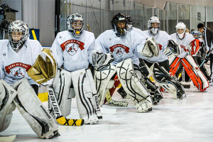 Group of young goalies practicing footwork