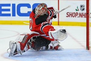 Cory Schneider with a glove save on Montreal Canadiens' Tomas Plekanec