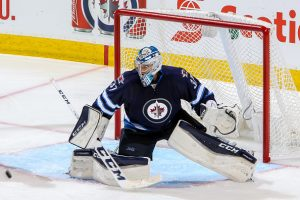 Connor Hellebuyck making cross-crease save