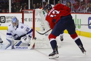 Vasilevskiy stopping a shot from Washington forward Jakub Vrana