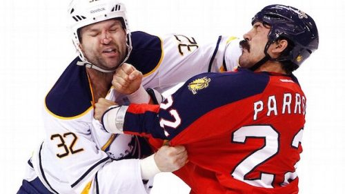 "Ex-NHL ""tough guys"" John Scott and George Parros fighting"