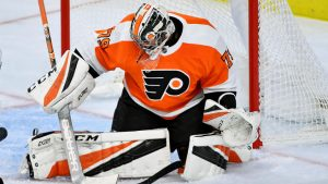 Hart making a save in a preseason game with the Flyers wearing #79, which he has chosen to keep in the regular season