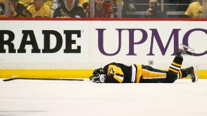 Pittsburgh Penguins Captain Sidney Crosby concussed on the ice after a collision with the boards