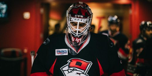 Alex Nedeljkovic in a Charlotte Checkers sweater