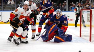 Binnington sports the Blues' throwback jerseys in a game against the Calgary Flames