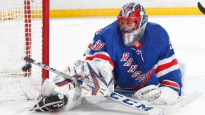 Igor Shesterkin stretches out for a blocker save in close