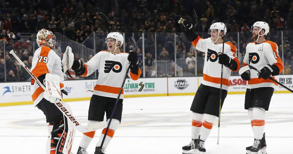 Carter Hart and teammates celebrate a win in the 2019-20 season (Winslow Townson, USA Today Sports via Philly Voice)